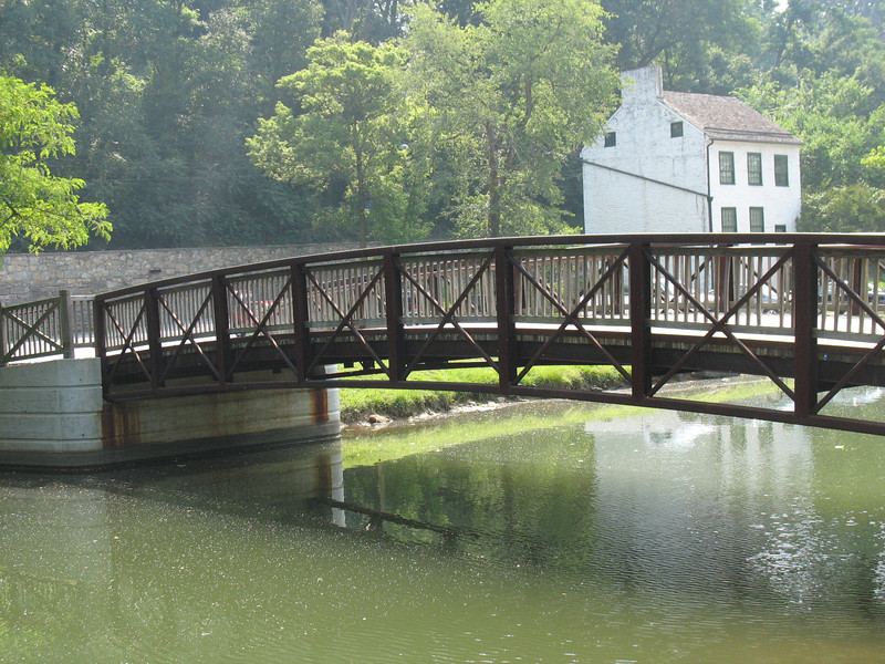 The Chesapeake & Ohio Canal National Historic Park follows the route of the Potomac River for 184.5 miles from the Georgetown neighborhood of Washington, D.C., to Cumberland, MD. A total of $2,673,961 in TE money has been spent on this project, with five TE awards totaling $1,027,658 spent on the Washington, D.C., section and an additional $1,646,303, from two TE awards, spent on the Maryland section of the C&O Canal. The TE awards went toward rehabilitating various segments of the canal and the adjacent towpath and constructing several pedestrian bridges, which provide pedestrians and cyclists with safe access points to the towpath.  On several of these projects, the National Park Service was a key partner.<br /> <br /> Hundreds of original structures, including locks, lockhouses and aqueducts, serve as reminders of the canal's role as a transportation system during the Canal Era. In addition, the canal's towpath provides a nearly level, continuous trail through the spectacular scenery of the Potomac River Valley. The canal towpath trail connects to the Grand Allegheny Passage rail-trail, creating a bicycle route connecting DC all the way to Pittsburgh, PA.  Most of the annual visitation is concentrated in the first 14 miles of the canal -- from Georgetown to Great Falls. Solitude and quiet are easily found in the upper areas of the canal much of the year.