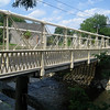 "<a href=""http://www.flickr.com/people/wallyg/"">Photo Credit</a>  The 140 year-old Hunterdon County Bridge is still in use thanks to a $340,000 TE award for its restoration. Farmers, traveling with horse drawn carts, used this bridge over the south branch of the Raritan River when they came to market to sell their goods and purchase supplies. Over the years the bridge fell into disrepair, trusses were bent or broken, bolt hangers, and the stone masonry began to deteriorate. Maintenance was done on an emergency basis or deferred; bridge inspectors noted the structure's historic significance while recommending that the whole structure be replaced. Due to the historic significance of the bridge and public support, the county opted to rehabilitate the bridge. Rehabilitating the bridge proved to be the best decision all around: it was less expensive than replacing the bridge, it would require less closure time and not affect bike, pedestrian, or canoe travel on the river below, and its historic elements made it eligible for TE funding. The restored Hunterdon County Bridge not only connects Main Street businesses with a historic mill and museum, but it also provides the community with a link to its past while they travel to their future."