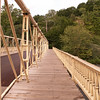 """<a href=""""http://www.historicbridges.org/"""">Photo Courtesy of Rick McOmber with Historicbridges.org</a>  The 140 year-old Hunterdon County Bridge is still in use thanks to a $340,000 TE award for its restoration. Farmers, traveling with horse drawn carts, used this bridge over the south branch of the Raritan River when they came to market to sell their goods and purchase supplies. Over the years the bridge fell into disrepair, trusses were bent or broken, bolt hangers, and the stone masonry began to deteriorate. Maintenance was done on an emergency basis or deferred; bridge inspectors noted the structure's historic significance while recommending that the whole structure be replaced. Due to the historic significance of the bridge and public support, the county opted to rehabilitate the bridge. Rehabilitating the bridge proved to be the best decision all around: it was less expensive than replacing the bridge, it would require less closure time and not affect bike, pedestrian, or canoe travel on the river below, and its historic elements made it eligible for TE funding. The restored Hunterdon County Bridge not only connects Main Street businesses with a historic mill and museum, but it also provides the community with a link to its past while they travel to their future."""