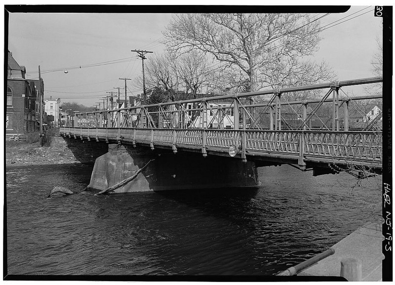 """Photos taken by Jack E. Baucher in 1971 and available online at the <a href=""""http://memory.loc.gov/cgi-bin/ampage?collId=hhphoto&fileName=nj/nj0100/nj0144/photos/browse.db&action=browse&recNum=0&title2=West%20Main%20Street%20Bridge,%20Spanning%20South%20branch%20of%20Raritan%20River,%20Clinton,%20Hunterdon,%20NJ&displayType=1&itemLink=r?ammem/hh:@field%28DOCID+@lit%28NJ0144%29%29"""">American  Memories</a> collection of the Library of Congress.   The 140 year-old Hunterdon County Bridge is still in use thanks to a $340,000 TE award for its restoration. Farmers, traveling with horse drawn carts, used this bridge over the south branch of the Raritan River when they came to market to sell their goods and purchase supplies. Over the years the bridge fell into disrepair, trusses were bent or broken, bolt hangers, and the stone masonry began to deteriorate. Maintenance was done on an emergency basis or deferred; bridge inspectors noted the structure's historic significance while recommending that the whole structure be replaced. Due to the historic significance of the bridge and public support, the county opted to rehabilitate the bridge. Rehabilitating the bridge proved to be the best decision all around: it was less expensive than replacing the bridge, it would require less closure time and not affect bike, pedestrian, or canoe travel on the river below, and its historic elements made it eligible for TE funding. The restored Hunterdon County Bridge not only connects Main Street businesses with a historic mill and museum, but it also provides the community with a link to its past while they travel to their future."""