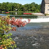 "<a href=""http://www.flickr.com/people/puzzler4879/"">Photo Credit</a>  <b>A beautiful view of the <a href=""http://theredmill.org/"">Red Mill Museum</a> from the bridge.</b>  The 140 year-old Hunterdon County Bridge is still in use thanks to a $340,000 TE award for its restoration. Farmers, traveling with horse drawn carts, used this bridge over the south branch of the Raritan River when they came to market to sell their goods and purchase supplies. Over the years the bridge fell into disrepair, trusses were bent or broken, bolt hangers, and the stone masonry began to deteriorate. Maintenance was done on an emergency basis or deferred; bridge inspectors noted the structure's historic significance while recommending that the whole structure be replaced. Due to the historic significance of the bridge and public support, the county opted to rehabilitate the bridge. Rehabilitating the bridge proved to be the best decision all around: it was less expensive than replacing the bridge, it would require less closure time and not affect bike, pedestrian, or canoe travel on the river below, and its historic elements made it eligible for TE funding. The restored Hunterdon County Bridge not only connects Main Street businesses with a historic mill and museum, but it also provides the community with a link to its past while they travel to their future."