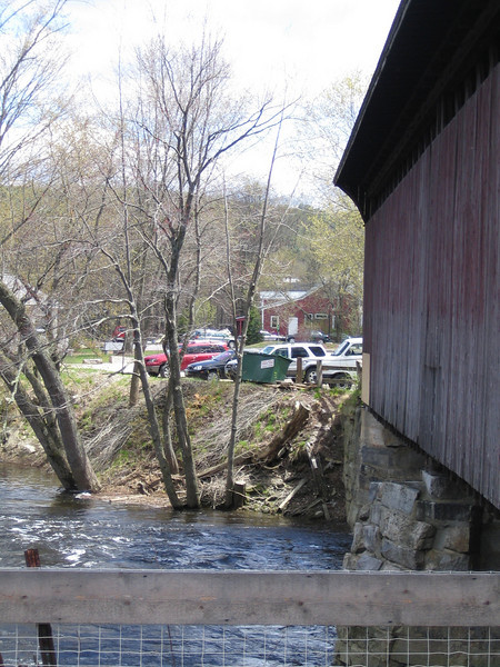 "This bridge, disputably the oldest covered bridge in the United States, was built in 1850 for the Concord and Claremont Railroad, connecting lonely Contoocook with the larger New Hampshire towns such as Concord. A ""day of great festivity"" was held upon the opening of this bridge, with the rousing sounds of impassioned speeches, lively bands, and cannon thunder. The bridge was partly destroyed by flooding two separate times in the 1930's, and was eventually used as a warehouse from 1962-1990. In 1990 it was placed in the National Register of Historic Places, and the bridge was fully restored with help from a $119,200 TE grant and local match of $29,800 in 2005."