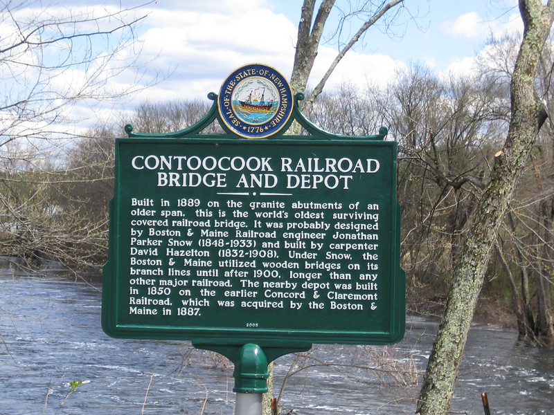 """This bridge, disputably the oldest covered bridge in the United States, was built in 1850 for the Concord and Claremont Railroad, connecting lonely Contoocook with the larger New Hampshire towns such as Concord. A """"day of great festivity"""" was held upon the opening of this bridge, with the rousing sounds of impassioned speeches, lively bands, and cannon thunder. The bridge was partly destroyed by flooding two separate times in the 1930's, and was eventually used as a warehouse from 1962-1990. In 1990 it was placed in the National Register of Historic Places, and the bridge was fully restored with help from a $119,200 TE grant and local match of $29,800 in 2005."""