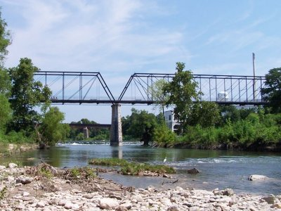 "This category 7 project rehabilitated the historic Faust Street Bridge in New Braunfels, TX. The bridge was originally built by the King Bridge Company of Cleveland, Ohio in 1887 to span the Guadalupe River. The construction of the bridge was funded by Comal County with an initial price tag of $33,269. It is the only multiple-span Whipple Truss Bridge in the state of Texas that resides at its original site.  In 1978, as a result of a fire, the bridge was closed to traffic. Thanks to $360,000 in Transportation Enhancements funding and a local match of $72,000 in 1994 the bridge is still here today. The category 7 project rehabilitated the bridge so that it could be used to carry pedestrians and bicyclists across the Guadalupe River. The rehabilitation was carried out by the <a href=""http://www.sparksengineering.com/"">Sparks Engineering, Inc.</a> who also worked on the nearby <a href=""http://www.images.enhancements.org/7-Rehab-Hist-Transp-Facilities/Hays-Street-Bridge/"">Hays Street Bridge</a>  in San Antonio.   Visit the <a href=""http://historicbridgefoundation.com/txbridges/hillcountry/comal/faust.html "">Historic Bridge Foundation </a> for more information on the bridge."