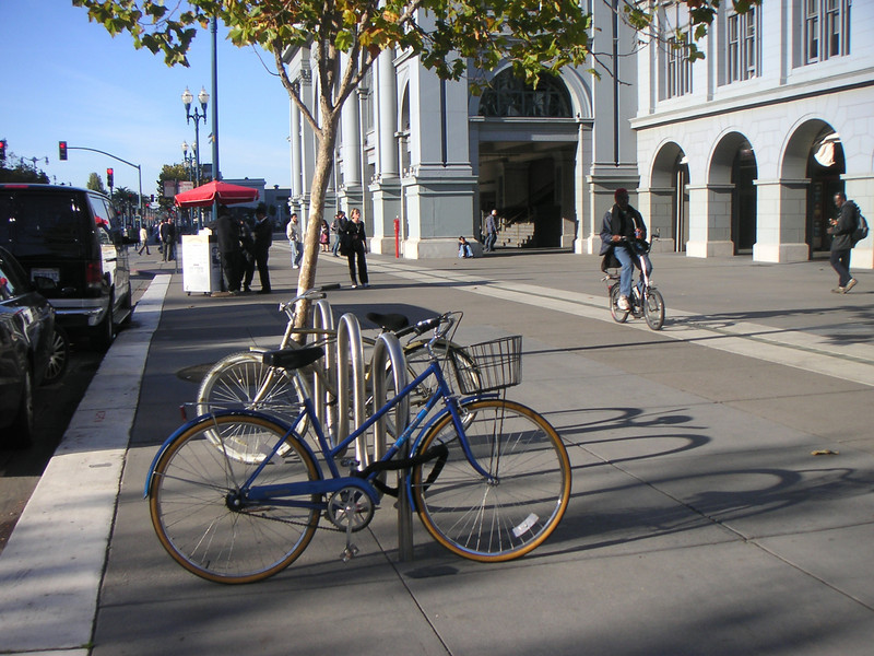 "Along with bicycle lanes, bike parking encourages active transportation.  The <a href=""http://www.ferrybuildingmarketplace.com/"">Ferry Building</a>, built in 1898, has survived two major earthquakes and is listed in the National Register of Historic Places. Though it is now a major inter-modal transportation center and mixed-use complex, it has not always been so. Until the opening of the Bay and Golden Gate Bridges in 1936 and 1937, respectively, the Ferry Building was the focal point of ferry and rail transportation. When auto travel became the dominant mode for traveling across the Bay, the Ferry Building became obsolete and was transformed into primarily office use. To make matters worse, the elevated Embarcadero Freeway was built directly in front of the building in 1957 cutting the building off from the rest of downtown. The 1989 Loma Prieta Earthquake instigated the redevelopment of the Embarcadero and the Ferry Building when it destroyed part of the elevated freeway.    Two TE awards, procured in 1995 and 1998, were used to complete the Ferry Building Rehabilitation project. In total, State TE funding amounted to $2 million and generated a total local match of $2,201,000. Today, visitors and commuters from East Bay and Marin County can connect to downtown San Francisco via passenger ferries, light rail, the subway system, historic streetcars, cable cars, and buses. In addition, the Ferry Building is now truly mixed-use with retail shops, restaurants, food markets, conference center, and office space fill its historic space."