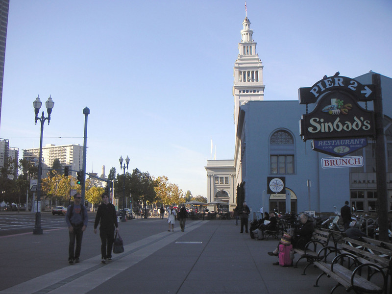 "The Ferry Building's restaurants, wine bar, and oyster bar spill out on all sides of the building. Generous sidewalks accommodate various simultaneous users.    The <a href=""http://www.ferrybuildingmarketplace.com/"">Ferry Building</a>, built in 1898, has survived two major earthquakes and is listed in the National Register of Historic Places. Though it is now a major inter-modal transportation center and mixed-use complex, it has not always been so. Until the opening of the Bay and Golden Gate Bridges in 1936 and 1937, respectively, the Ferry Building was the focal point of ferry and rail transportation. When auto travel became the dominant mode for traveling across the Bay, the Ferry Building became obsolete and was transformed into primarily office use. To make matters worse, the elevated Embarcadero Freeway was built directly in front of the building in 1957 cutting the building off from the rest of downtown. The 1989 Loma Prieta Earthquake instigated the redevelopment of the Embarcadero and the Ferry Building when it destroyed part of the elevated freeway.    Two TE awards, procured in 1995 and 1998, were used to complete the Ferry Building Rehabilitation project. In total, State TE funding amounted to $2 million and generated a total local match of $2,201,000. Today, visitors and commuters from East Bay and Marin County can connect to downtown San Francisco via passenger ferries, light rail, the subway system, historic streetcars, cable cars, and buses. In addition, the Ferry Building is now truly mixed-use with retail shops, restaurants, food markets, conference center, and office space fill its historic space."