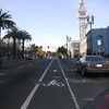 "Generous bicycle lanes along The Embarcadero and Market Street connect cyclists to the Ferry Building's retail and transportation options.  The <a href=""http://www.ferrybuildingmarketplace.com/"">Ferry Building</a>, built in 1898, has survived two major earthquakes and is listed in the National Register of Historic Places. Though it is now a major inter-modal transportation center and mixed-use complex, it has not always been so. Until the opening of the Bay and Golden Gate Bridges in 1936 and 1937, respectively, the Ferry Building was the focal point of ferry and rail transportation. When auto travel became the dominant mode for traveling across the Bay, the Ferry Building became obsolete and was transformed into primarily office use. To make matters worse, the elevated Embarcadero Freeway was built directly in front of the building in 1957 cutting the building off from the rest of downtown. The 1989 Loma Prieta Earthquake instigated the redevelopment of the Embarcadero and the Ferry Building when it destroyed part of the elevated freeway.    Two TE awards, procured in 1995 and 1998, were used to complete the Ferry Building Rehabilitation project. In total, State TE funding amounted to $2 million and generated a total local match of $2,201,000. Today, visitors and commuters from East Bay and Marin County can connect to downtown San Francisco via passenger ferries, light rail, the subway system, historic streetcars, cable cars, and buses. In addition, the Ferry Building is now truly mixed-use with retail shops, restaurants, food markets, conference center, and office space fill its historic space."