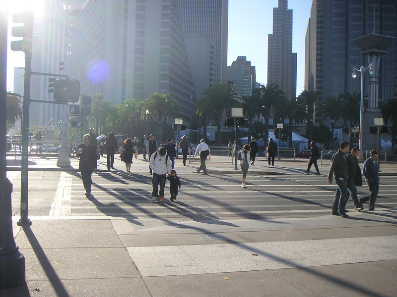 "Wide crosswalks accommodate the heavy volume of Ferry Building visitors.  The <a href=""http://www.ferrybuildingmarketplace.com/"">Ferry Building</a>, built in 1898, has survived two major earthquakes and is listed in the National Register of Historic Places. Though it is now a major inter-modal transportation center and mixed-use complex, it has not always been so. Until the opening of the Bay and Golden Gate Bridges in 1936 and 1937, respectively, the Ferry Building was the focal point of ferry and rail transportation. When auto travel became the dominant mode for traveling across the Bay, the Ferry Building became obsolete and was transformed into primarily office use. To make matters worse, the elevated Embarcadero Freeway was built directly in front of the building in 1957 cutting the building off from the rest of downtown. The 1989 Loma Prieta Earthquake instigated the redevelopment of the Embarcadero and the Ferry Building when it destroyed part of the elevated freeway.    Two TE awards, procured in 1995 and 1998, were used to complete the Ferry Building Rehabilitation project. In total, State TE funding amounted to $2 million and generated a total local match of $2,201,000. Today, visitors and commuters from East Bay and Marin County can connect to downtown San Francisco via passenger ferries, light rail, the subway system, historic streetcars, cable cars, and buses. In addition, the Ferry Building is now truly mixed-use with retail shops, restaurants, food markets, conference center, and office space fill its historic space."