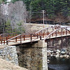 "<a href=""http://www.flickr.com/people/21561428@N03/"">Photo Credit</a>  Since 1813, a bridge has crossed over the Sacandaga River in the same spot that the Hadley Bow Bridge still stands. The Hadley Bow Bridge was built in 1885 on the abutments of an older bridge and served pedestrians and vehicles until 1983, when it was closed due to severe deterioration. Saratoga County had planned to dismantle the bridge but as a result of local lobbying to save the bridge, Saratoga County planned efforts to rehabilitate the bridge.  Ryan-Bigss Associates prepared a Historic Structures Report which outlined the condition and options for the bridge. When Saratoga County received a Transportation Enhancement award for $1.16 million to rehabilitate the bridge, <a href=""http://www.ryanbiggs.com/bridges/hadley-bow-bridge/"">Ryan-Biggs Associates</a> was selected for the category 7 project. The project included the stabilization and rehabilitation of the existing bridge and construction of an independent supports system to bring the bridges load bearing capacity up to the modern standards. The bridge is of National Historic Civil Engineering importance and was added to the National Registry of Historic Places in 1977. It provides a key link to a popular scenic vista of the Sacandaga River and nearby footpaths."