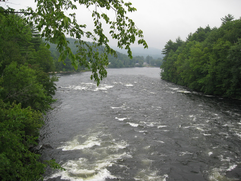 "<a href=""http://www.flickr.com/people/dougtone/"">Photo Courtesy of Doug Kerr</a>  Since 1813, a bridge has crossed over the Sacandaga River in the same spot that the Hadley Bow Bridge still stands. The Hadley Bow Bridge was built in 1885 on the abutments of an older bridge and served pedestrians and vehicles until 1983, when it was closed due to severe deterioration. Saratoga County had planned to dismantle the bridge but as a result of local lobbying to save the bridge, Saratoga County planned efforts to rehabilitate the bridge.  Ryan-Bigss Associates prepared a Historic Structures Report which outlined the condition and options for the bridge. When Saratoga County received a Transportation Enhancement award for $1.16 million to rehabilitate the bridge, <a href=""http://www.ryanbiggs.com/bridges/hadley-bow-bridge/"">Ryan-Biggs Associates</a> was selected for the category 7 project. The project included the stabilization and rehabilitation of the existing bridge and construction of an independent supports system to bring the bridges load bearing capacity up to the modern standards. The bridge is of National Historic Civil Engineering importance and was added to the National Registry of Historic Places in 1977. It provides a key link to a popular scenic vista of the Sacandaga River and nearby footpaths."