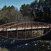 "<a href=""http://www.flickr.com/people/roys-stuff/"">Photo Courtesy of Roy Saplin</a>  Since 1813, a bridge has crossed over the Sacandaga River in the same spot that the Hadley Bow Bridge still stands. The Hadley Bow Bridge was built in 1885 on the abutments of an older bridge and served pedestrians and vehicles until 1983, when it was closed due to severe deterioration. Saratoga County had planned to dismantle the bridge but as a result of local lobbying to save the bridge, Saratoga County planned efforts to rehabilitate the bridge.  Ryan-Bigss Associates prepared a Historic Structures Report which outlined the condition and options for the bridge. When Saratoga County received a Transportation Enhancement award for $1.16 million to rehabilitate the bridge, <a href=""http://www.ryanbiggs.com/bridges/hadley-bow-bridge/"">Ryan-Biggs Associates</a> was selected for the category 7 project. The project included the stabilization and rehabilitation of the existing bridge and construction of an independent supports system to bring the bridges load bearing capacity up to the modern standards. The bridge is of National Historic Civil Engineering importance and was added to the National Registry of Historic Places in 1977. It provides a key link to a popular scenic vista of the Sacandaga River and nearby footpaths."