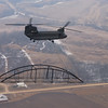 "Photo Credit: Iowa Army National Guard<br /> <br /> A Chinook in flight with one of the bridge spans.<br /> <br /> The Hale Bridge has helped travelers cross the Wapsipinicon River in Iowa since 1879.  Damaged by floods in 1993, the bridge was closed to traffic in 1997.  However, the bridge was nominated for the National Register of Historic Places in 1998 as the longest-standing bowstring arch bridge in Iowa.  In 2003, the bridge was moved to storage by a planning group composed of representatives from the state DOT, the Federal Highway Administration, Jones County, the Hale area, and the state historical society.  After a three-year restoration, the bridge was relocated 12 miles by air thanks to the Iowa Army National Guard, to Wapsipinicon State Park, where it serves as a pedestrian bridge.<br /> <br /> The move and the restoration were paid for in part with a Transportation Enhancements grant of $159,000.  The move was featured on the History Channel's ""Mega Movers,"" a clip of which can be viewed here: <a href=""http://www.history.com/video.do?name=science&bcpid=1681694253&bclid=1685978756&bctid=1551056441"">http://www.history.com/video.do?name=science&bcpid=1681694253&bclid=1685978756&bctid=1551056441</a>"