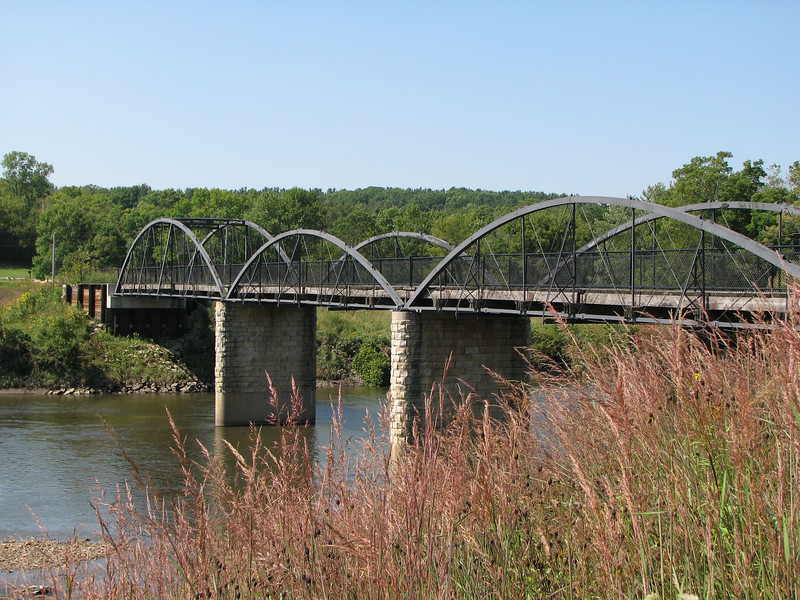 """The Hale Bridge has helped travelers cross the Wapsipinicon River in Iowa since 1879.  Damaged by floods in 1993, the bridge was closed to traffic in 1997.  However, the bridge was nominated for the National Register of Historic Places in 1998 as the longest-standing bowstring arch bridge in Iowa.  In 2003, the bridge was moved to storage by a planning group composed of representatives from the state DOT, the Federal Highway Administration, Jones County, the Hale area, and the state historical society.  After a three-year restoration, the bridge was relocated 12 miles by air thanks to the Iowa Army National Guard, to Wapsipinicon State Park, where it serves as a pedestrian bridge.<br /> <br /> The move and the restoration were paid for in part with a Transportation Enhancements grant of $159,000.  The move was featured on the History Channel's """"Mega Movers,"""" a clip of which can be viewed here: <a href=""""http://www.history.com/video.do?name=science&bcpid=1681694253&bclid=1685978756&bctid=1551056441"""">http://www.history.com/video.do?name=science&bcpid=1681694253&bclid=1685978756&bctid=1551056441</a>"""