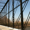 Photo Courtesy of Tony Dillon<br /> <br /> In Aurora, Indiana just south of Lawrenceburg, lies a one-of-a-kind Triple Whipple Bridge. The only known Triple Whipple or Triple Intersection Pratt Truss in existence in the United States has a long history earning it a place on the National Register of Historic Places. The bridge was originally built by the Wrought Iron Bridge Company of Canton, Ohio and was one of the largest bridges at the time of it design. The Trusses stand 40 feet tall and stretch 300 feet across the Laughery Creek. The bridge was built in 1878 on stone abutments from 1867. <br /> <br /> Work began in April of 2008 to rehabilitate the bridge. $1.32 million in Transportation Enhancement funding was matched by $329,000 in local funds to address the bridges deficiencies. The project included cleaning and painting the cast and wrought iron truss structure, replacement of pole railing, the clearing of overgrown vegetation, and the repair of the original stone abutments. In addition, parking lots were added at each end of the bridge for visitor parking. The project was completed in the spring of 2009 by the Faulkner Construction company from Louisville, Kentucky.