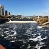 "<b>The view of St. Anthony's Falls from the bridge.</b>  Over $2 million in TE funds have been used to restore the <a href=""http://www.mrdbridges.com/stoneArch.php"">Stone Arch Bridge</a>, a former railroad bridge crossing the only waterfall, Saint Anthony Falls, on the Mississippi River.  The nationally registered historic bridge dates back to 1883 and is now used by pedestrians, bicyclists, and a short-line trolley.  The Stone Arch Bridge is used daily by commuters and recreation seekers in Minneapolis, nearby suburbs, and the University of Minnesota.  The bridge provides access to <a href=""http://www.minneapolisparks.org/default.asp?PageID=4&parkid=413"">Mill Ruins Park</a> (which received $775,000 in TE funds in 2003 for a pedestrian circulation system) and the St. Anthony Falls Heritage Trail, a two mile trail with an extensive array of interpretive and directional signs noting the early days of the city and the historic flour mill district.  It is also one of many sites along the <a href=""http://www.minneapolisparks.org/grandrounds/home.htm"">Grand Rounds National Scenic Byway</a> (where bicycle and pedestrian wayfinding improvements were implemented through $715,000 in TE funds in 2003).  The restoration of the Stone Arch Bridge would not have been possible had it not been for the partnership between the Minnesota Department of Transportation, the Minnesota Historical Society and the local Saint Anthony Falls Heritage Board."
