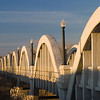 "<a href=""http://www.flickr.com/people/photokayaker/"">Photo Credit</a> The Rainbow Arch Bridge in Fort Morgan, Colorado, is the only bridge of its kind in the state and one of the longest of its kind in the country. The remarkable bridge design includes 11 graceful arches that together stretch 1,100 feet over the South Platte River. This exceptional design won the bridge a space on the National Register of Historic Places and designation as a Colorado Civil Engineering Landmark. The unique character of the bridge also inspired a local community group, the Fort Morgan Historical Society, to save the aging bridge from collapse in the early 1990s. The Society worked with the city of Fort Morgan and the Colorado Historical Society to generate matching funds for a two- phase TE award to restore the bridge for pedestrian use. Today, it is a popular tourist attraction and a center for community events such as the annual Tin Man Triathlon. In addition, the Rainbow Arch Bridge serves as the entrance to the <a href=""http://www.coloradodot.info/travel/scenic-byways/northeast/pawnee-pioneer-trails"">Pawnee  Pioneer Trails</a>, a part of Colorado's Scenic and Historic Byways system."