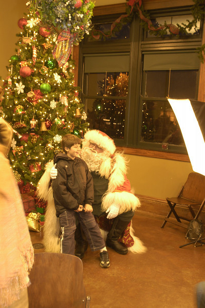 <b>The depot now serves as a community center for events in downtown Russellville, including a visit from Santa.</b>  The mission of the TE program is to advance the construction of a surface transportation system that is positively integrated with the economic, social, human, and environmental framework it is embedded in. This is based on an understanding that relating to surface transportation involves ties beyond those of use or proximity. In 1996, a group of concerned citizens, volunteers, and staff at Main Street Russellville understood this relationship when they formed the Friends of the Depot with the purpose of saving the historic Missouri-Pacific Railroad Depot in Russellville, Arkansas (pop. 27,602).   Once a bustling depot (built 1916) that connected passengers along the Missouri-Pacific Railroad to other cities throughout the south and west, the depot closed to the public in 1960 when passenger service discontinued. Union Pacific converted the depot for office use and storage, and though it did not suffer from major structural damage, the Friends group recognized that the depot and its historic connection to the railroad and the community was slipping away. The depot served as a transportation hub for nearly 45 years, and elderly members of the community recall their parents' connection to the railroad as either passengers or railroad workers. The depot itself had a somewhat dark connection to the segregated south, with a separate waiting room for colored passengers.  The 1992 listing of the depot in the National Register of Historic Places was the first stage in saving the depot. Restoration took place in two phases between 2000 and 2002 with three TE grants totaling $555,000. The community matched these grants with over $200,000.   The restoration of this historic depot now serves the greater community of Russellville, which had lacked a space for civic engagement. The depot fills that void by providing a venue for special events and serving as a visi