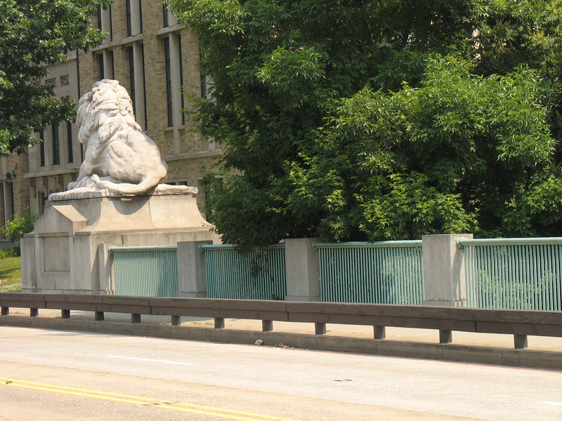 Transportation Enhancement funds have been used in Washington, DC to restore iconic bridge sculptures at two locations: the buffaloes on the Dumbarton Bridge (Q Street) and the lions on the Taft Bridge (Connecticut Avenue).<br /> <br /> The Dumbarton Bridge buffaloes were originally cast in bronze by Alexander Phimister Proctor. The bridge was built in 1914/15, and is on the National Register of Historic Places. Over the decades, weathering and acid rain corroded the bronze and turned the buffaloes a greenish color, obscuring much of the original detail in the bronze castings. In 2006, the original buffaloes were restored to their original glory and protected with a wax coating using $49,890 in TE funds, part of over $100,000 raised by the Dupont Circle Conservancy and the Georgetown Citizens Association for the project.<br /> <br /> The Taft Bridge lions were molded in concrete in 1907 by Roland Hinton Perry and put in place with the new bridge bearing Connecticut Avenue over Rock Creek Park. The original lions deteriorated over the years to the point where the lions were removed from the bridge in 1993.  A $598,000 TE grant, combined with $149,500 in local funds, enabled the fabrication of replicas of the original sculptures, which were installed in 2000. The Taft Bridge, built in the Classical Revival style, is also on the National Register of Historic Places.
