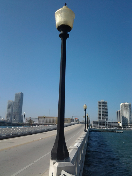 "Photo Credit: Tracy Loh   In 1926 the Venetian Causeway was conceived as a way to connect mainland Miami with the south end of Miami Beach through six uninhabited islands. As the population of Miami Beach and the Islands increased, the <a href=""http://www.dot.state.fl.us"">Florida Department of Transportation</a> saw the need to construct a new bridge in place of the Causeway, which is on the National Register of Historic Places. Local citizens fought hard to preserve the Art Deco Bridge and eventually partnered with FDOT.   Over the past 20 years 7 Transportation Enhancements (TE) projects have helped to restore and rehabilitate the Causeway. The <a href=""https://www.bigtent.com/groups/vcna"">Venetian Causeway Neighborhood Alliance</a> and FDOT worked together throughout the project to ensure it meet the community's desires, FDOT even designated a Citizen Liaison. In 2003 the first round of projects helped to replace failed concrete segments and install period lighting fixtures. The good relationship established with the community helped ease tensions when delays were incurred. Later, in 2009 several other enhancements were added to the bridge and surrounding areas. Transportation Enhancement funding has helped to rehabilitate and preserve the historic bridge for future generations as well as make it more bicycle and pedestrian friendly."