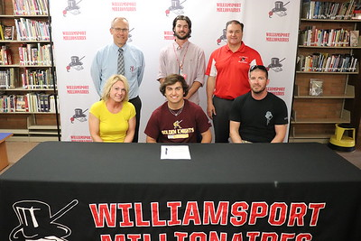 Brayton Rowello signed to play baseball at Gannon University. At back from left are Head Principal Dr. Brandon Pardoe, Head Baseball Coach Kyle Schneider and Athletic Director Sean McCann.  Seated with Rowello are parents Jennifer and Matthew Allis.