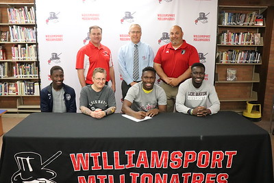 Thomas Pombor signs to play soccer at Lock Haven University.  From back left: Athletic Director Sean McCann, Head Principal Dr. Brandon Pardoe, Head Soccer Coach Lee Carr. Seated with Pombor, center, are his brothers Jimmy and Kolachi and mother, Kim Palmatier.