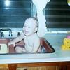 8-'75-Chris bathing in sink