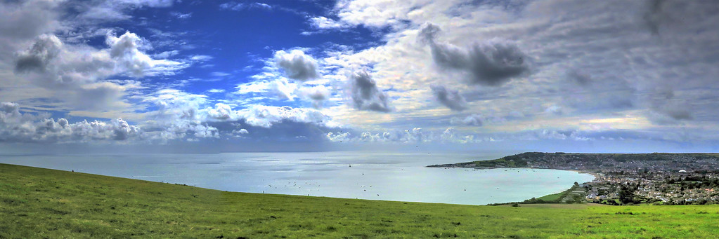A panorama shot of Swanage Bay with the town to the right
