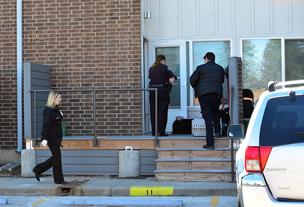. Police officers investigate the scene at 690 Manhattan Drive in Boulder on Wednesday morning.  For more photos of the scene go to www.dailycamera.com Paul Aiken Staff Photographer Feb 15 2017