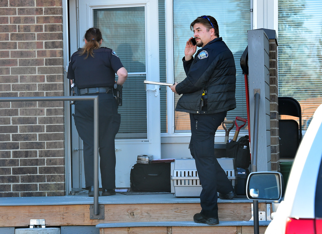 . Police officers and an animal control officer investigate the scene at 690 Manhattan Drive in Boulder on Wednesday morning.  For more photos of the scene go to www.dailycamera.com Paul Aiken Staff Photographer Feb 15 2017