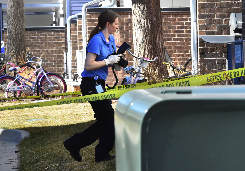. An investigator takes photos at 690 Manhattan Drive in Boulder on Wednesday morning.  For more photos of the scene go to www.dailycamera.com Paul Aiken Staff Photographer Feb 15 2017