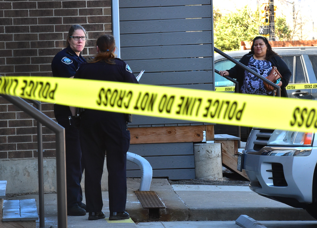 . Neighbors look at the scene at 690 Manhattan Drive in Boulder on Wednesday morning.  For more photos of the scene go to www.dailycamera.com Paul Aiken Staff Photographer Feb 15 2017