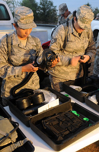 In this image released by the Texas Military Forces, Airmen with the 149th Fighter Wing assemble air purification systems at the Texas A&M University Riverside Campus during Joint Task Force 71's Homeland Response Force external evaluation Wednesday, October 12, 2011. The unit observed JTF 71 during the EXEVAL in preparation for joining the unit's medical team for the next evaluation in 18 months. As a HRF, JTF 71 will provide search and extraction, chemical decontamination and medical triage support to local, state and regional organizations during a mass casualty incident. (Photo/100th Mobile Public Affairs Detachment, Army National Guard Sgt. Suzanne Carter)