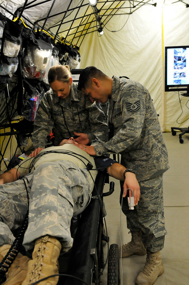In this image released by the Texas Military Forces, Tech. Sgt. Jesse Hernandez and Staff Sgt. Lydia Hoover check Senior Airman Larry Deluna for injuries at the 52nd annual National Guard Association of Texas Conference in Corpus Christi Saturday, March 26, 2011. The Airmen, part of the 149th Small Portable Expeditionary Aeromedical Rapid Response in Joint Task Force 71, participated in the conference to support JTF's Homeland Response Force mission. The HRF mission enables JTF-71 to respond quickly to incidents and work closely with civilian authorities. (Photo/100th Mobile Public Affairs Detachment, Army National Guard Spc. Suzanne Carter)