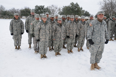 In this image released by the Texas Military Forces, Army National Guard Soldiers 436th Chemical Company with the CBRNE Battalion Task Force pause for a group photo in Fort Worth, Texas, Friday, Feb. 4, 2011. The Soldiers and Airmen deployed to North Texas as part of a training exercise by Joint Task Force 71 that focused on providing support to civilian authorities before and during the Super Bowl, as well as conducted training to develop new, future response capabilities.  CBRNE includes Air and Army National Guard members to deploy security, engineering, chemical decontamination and medical assets. (Photo/100th Mobile Public Affairs Detachment, Army National Guard Sgt. Melissa Bright)