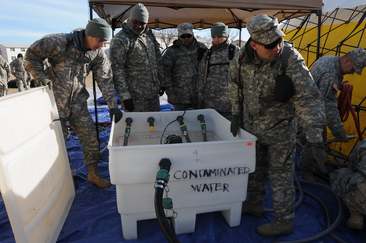 In this image released by the Texas Military Forces, Soldiers from the 436th Chemical Company practice setting up a decontamination site at Fort Wolters, Texas, Wednesday, Jan. 26, 2011. The 436th Chem. Co., out of Laredo, is one of several elements of the Texas CRBRNE Battalion Task Force in the Dallas/Fort Worth area as part of a mission in support of Super Bowl 45. Maintaining the skills to set up their equipment quickly enhances the unit's ability to readily deploy when called upon. (Photo/Joint Task Force 71, Army National Guard Sgt. Melissa Bright)