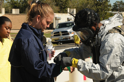 In this image released by the Texas Military Forces, Soldiers with the 6th Chemical, Biological, Radiological/Nuclear, and Explosive (CBRNE) – Enhanced Response Force Package help role-playing survivors find their way to the decontamination tents during the Texas Military Forces' Homeland Response Force certification exercise at a Texas Engineering Extension Service training facility in College Station, Texas, Thursday, October 13, 2011. Joint Task Force 71 completed the exercise as part of a National Guard Bureau certification process that highlighted the unit's Homeland Response Force capabilities in support of potential large-scale disasters in FEMA Region 6. The certification was the culmination of 18 months worth of training and recognizes the value that Texas Military Forces bring to the public and the emergency response community. (Photo/100th Mobile Public Affairs Detachment, Army National Guard Spc. Luke Elliott)