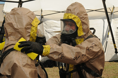 In this image released by the Texas Military Forces, Soldiers with the 6th Chemical, Biological, Radiological/Nuclear, and Explosive (CBRNE) – Enhanced Response Force Package decontaminate fellow workers during the Texas Military Forces' Homeland Response Force certification exercise at a Texas Engineering Extension Service training facility in College Station, Texas, Thursday, October 13, 2011. Joint Task Force 71 completed the exercise as part of a National Guard Bureau certification process that highlighted the unit's Homeland Response Force capabilities in support of potential large-scale disasters in FEMA Region 6. The certification was the culmination of 18 months worth of training and recognizes the value that Texas Military Forces bring to the public and the emergency response community. (Photo/100th Mobile Public Affairs Detachment, Army National Guard Spc. Luke Elliott)