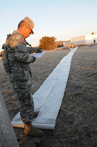 In this image released by the Texas Military Forces, Soldiers from the 436th Chemical Company practice setting up a decontamination site at Fort Wolters, Texas, Wednesday, Jan. 26, 2011. The unit, headquartered in Laredo, is one of several elements of the Texas CBRNE Battalion Task Force in the Dallas/Fort Worth area as part of a mission in support of Super Bowl 45. Maintaining the skills to set up their equipment quickly enhances the unit's ability to readily deploy when called upon. (Photo/Joint Task Force 71, Army National Guard Sgt. Melissa Bright)