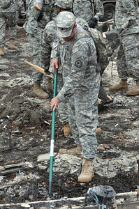 1st. Lt. Daniel Hart of the 436th Chemical Detachment assists with the cleanup of debris from the wildfires Nov. 19 in Bastrop, Texas.