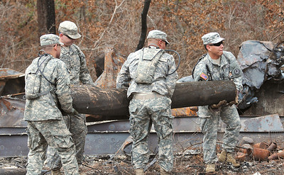 Soldiers of the 436th Chemical Detachment assist with the cleanup of debris from the wildfires in Bastrop, Texas.