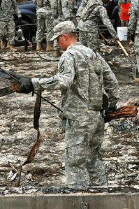 1st Lt. Stephen Thompson of the 436th Chemical Detachment assists with the cleanup of debris from the wildfires Nov. 19 in Bastrop, Texas.