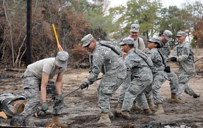 Soldiers of the 436th Chemical Detachment assist with the cleanup of debris from the wildfires Nov. 19 in Bastrop, Texas.