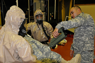In this image released by the Texas Military Forces, Pvt. Ismael Guillen with the 436th Chemical Company Detachment checks a casualty for contaminants at the 52nd annual National Guard Association of Texas Conference in Corpus Christi Saturday, March 26, 2011. The unit, along with other units from the Joint Task Force 71, participated in the conference to support its Homeland Response Force mission. The HRF mission enables JTF-71 to respond quickly to incidents and work closely with civilian authorities. (Photo/100th Mobile Public Affairs Detachment, Army National Guard Spc. Suzanne Carter)
