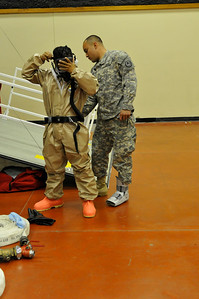 In this image released by the Texas Military Forces, Pvt. Ismael Guillen helps Sgt. Abren Mejia with the 436th Chemical Company Detachment put on a decontamination suit at the 52nd annual National Guard Association of Texas Conference in Corpus Christi Saturday, March 26, 2011. The unit, along with other units from the Joint Task Force 71, participated in the conference to support its Homeland Response Force mission. The HRF mission enables JTF-71 to respond quickly to incidents and work closely with civilian authorities. (Photo/100th Mobile Public Affairs Detachment, Army National Guard Spc. Suzanne Carter)