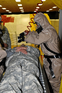 In this image released by the Texas Military Forces, Army Spc. Candido Godines with the 436th Chemical Company Detachment cleans contaminants off of a casualty at the 52nd annual National Guard Association of Texas Conference in Corpus Christi Saturday, March 26, 2011. The unit, along with other units from the Joint Task Force 71, participated in the conference to support its Homeland Response Force mission. The HRF mission enables JTF-71 to respond quickly to incidents and work closely with civilian authorities. (Photo/100th Mobile Public Affairs Detachment, Army National Guard Spc. Suzanne Carter)