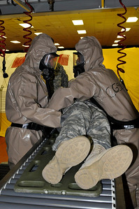 In this image released by the Texas Military Forces, Army Sgt. Abren Mejia (left) and Spc. Candido Godines with the 436th Chemical Company Detachment clean contaminants off a casualty at the 52nd annual National Guard Association of Texas Conference in Corpus Christi Saturday, March 26, 2011. The unit, along with other units from the Joint Task Force 71, participated in the conference to support its Homeland Response Force mission. The HRF mission enables JTF-71 to respond quickly to incidents and work closely with civilian authorities. (Photo/100th Mobile Public Affairs Detachment, Army National Guard Spc. Suzanne Carter)