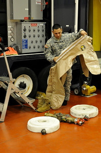 In this image released by the Texas Military Forces, Army Sgt. Abren Mejia with the 436th Chemical Company Detachment dons a decontamination suit at the 52nd annual National Guard Association of Texas Conference in Corpus Christi Saturday, March 26, 2011. The unit, along with other units from the Joint Task Force 71, participated in the conference to support its Homeland Response Force mission. The HRF mission enables JTF-71 to respond quickly to incidents and work closely with civilian authorities. (Photo/100th Mobile Public Affairs Detachment, Army National Guard Spc. Suzanne Carter)