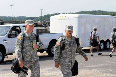 Army Col Lindemann and 1st Sgt Torres walking through the 436th Chemical Company decon set station.