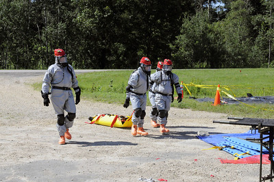 Soldiers of the 836 Engineer Company bring in a victim to the decon section for the crawl phase of the CERFP training.