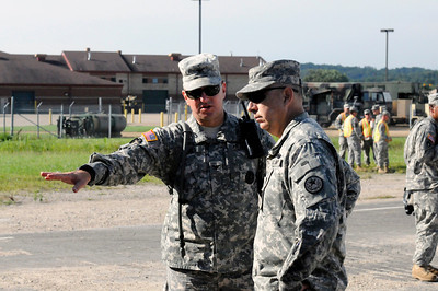 Col Bill Hall shows Maj Gen Jose S Mayorga how far the 6th CREFP's training has come in the six months since he took command.